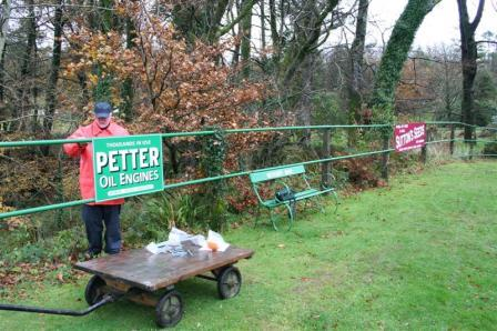 "Jim Pounds with the ""Petter Oil Engines"" sign installed on the down platform."