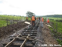 The track gang prepare sleepers up to the first occupation crossing